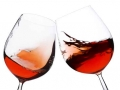 pair of moving wine glasses over a white background, cheers!
